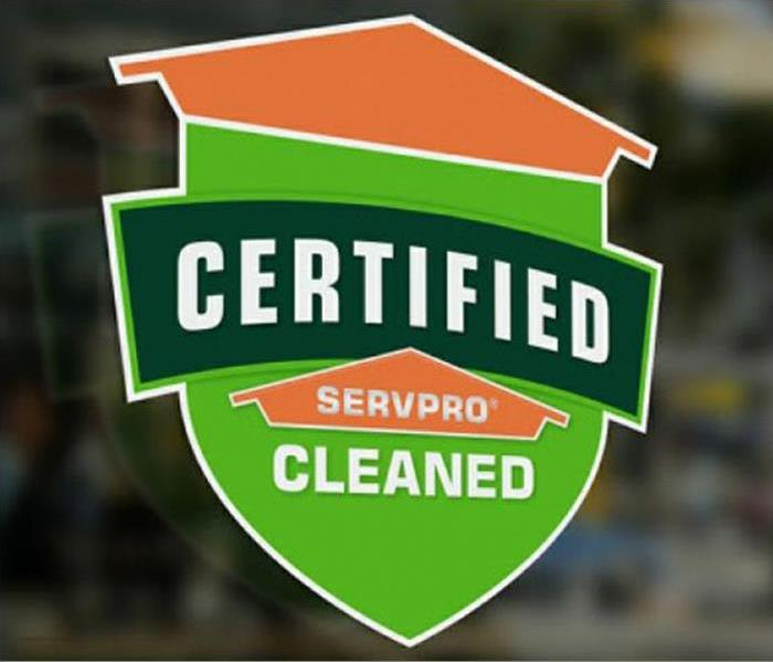 Certified: SERVPRO Cleaned badge on a window.